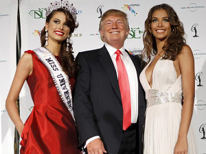 Miss Universe 2009 Fernandez stands with Trump and Miss Universe 2008 Mendoza after winning the crown at Atlantis on Paradise Island
